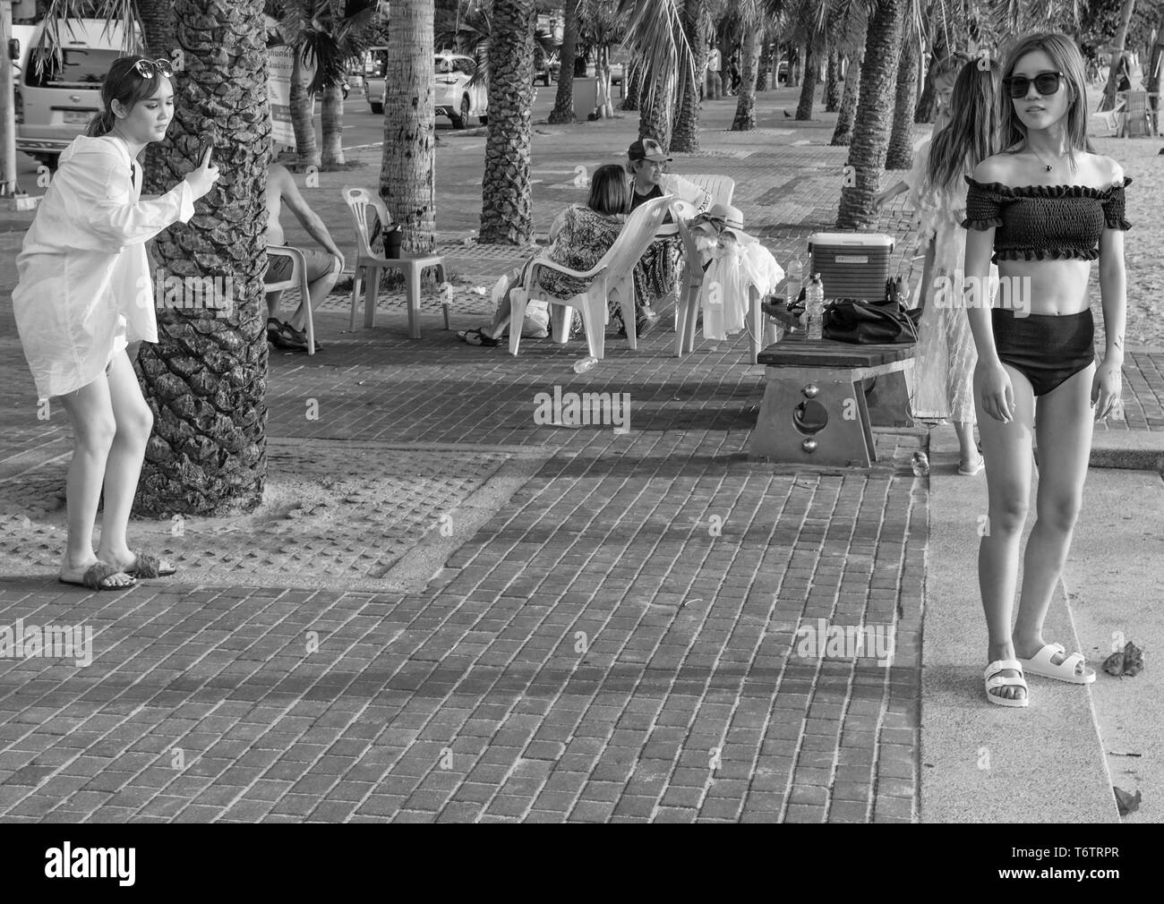 PATTAYA,THAILAND - APRIL 10,2019:The beach Four,young female Chinese tourists did a bikini shooting on the beach. - Stock Image