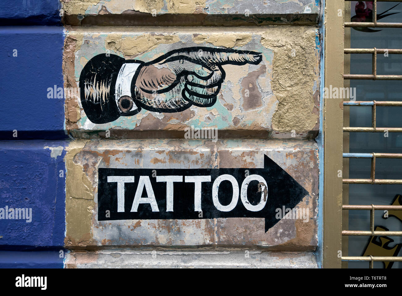 bad0d65c39936 Painted sign on the wall of a tattoo parlour in Edinburgh, Scotland, UK.