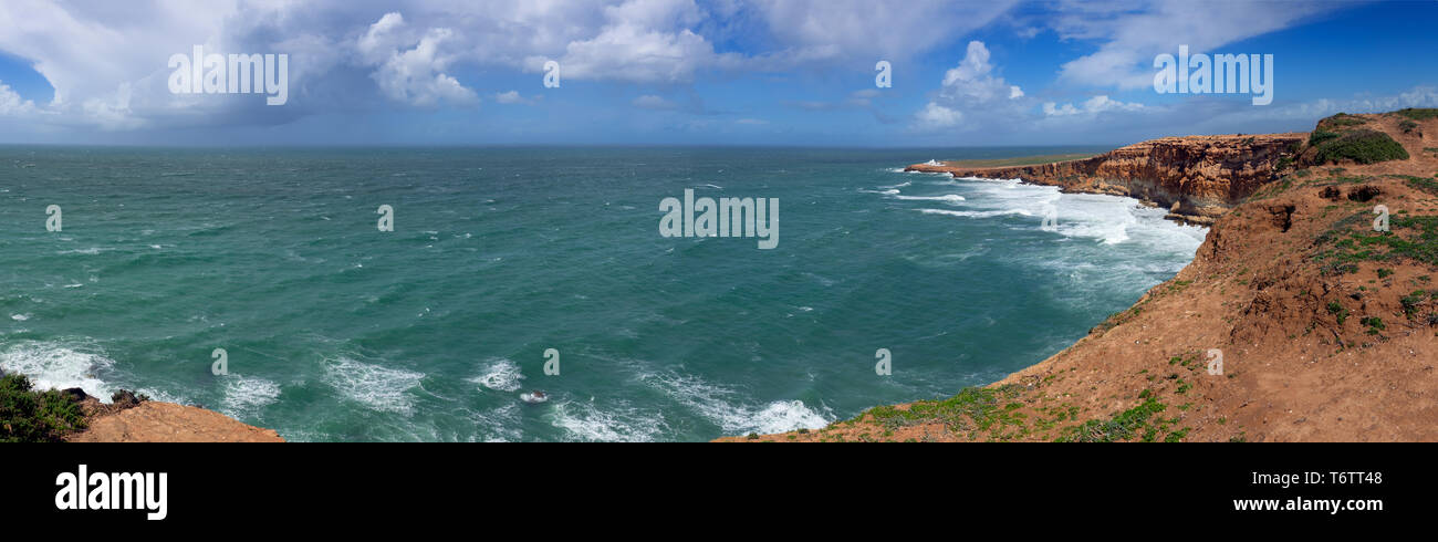 Ocean waves and rocks on Atlantic coast Stock Photo
