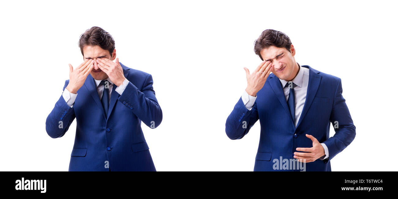 Young sick and unhappy businessman isolated on white background - Stock Image