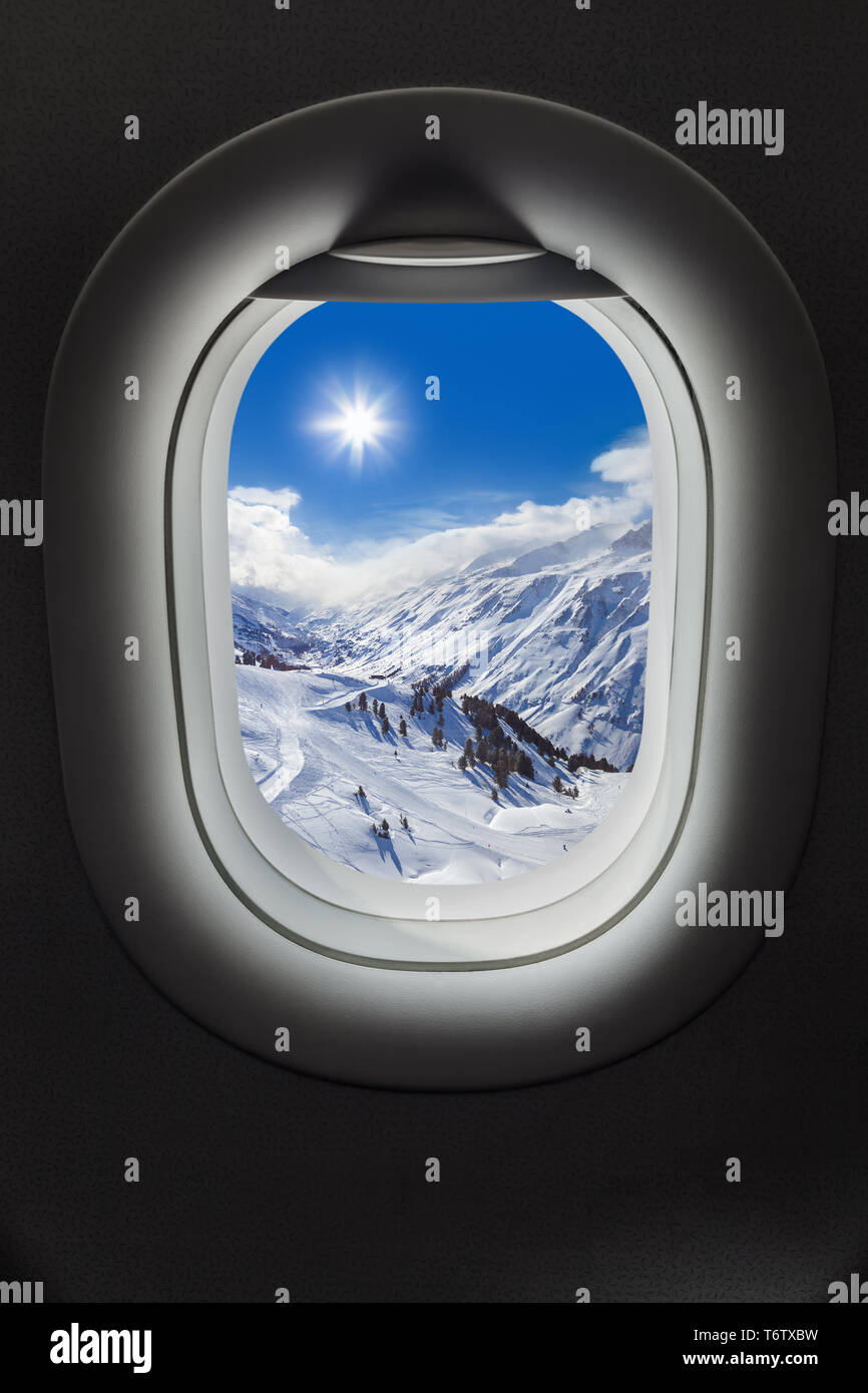 Mountains Alps at Austria in airplane window - Stock Image