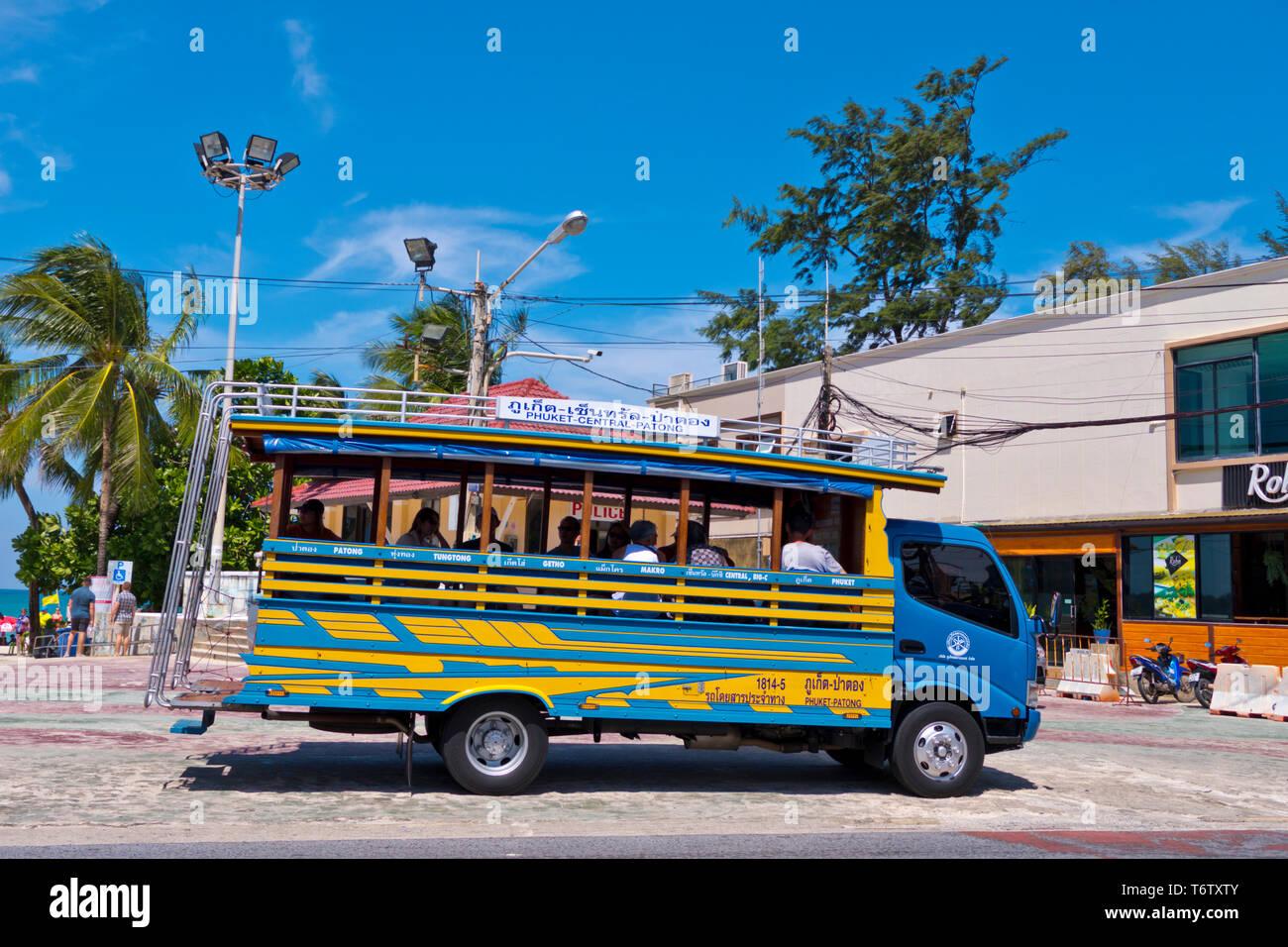 Phuket town-Patong bus, Beach Road, Thawewong Road, Patong, Phuket island, Thailand Stock Photo