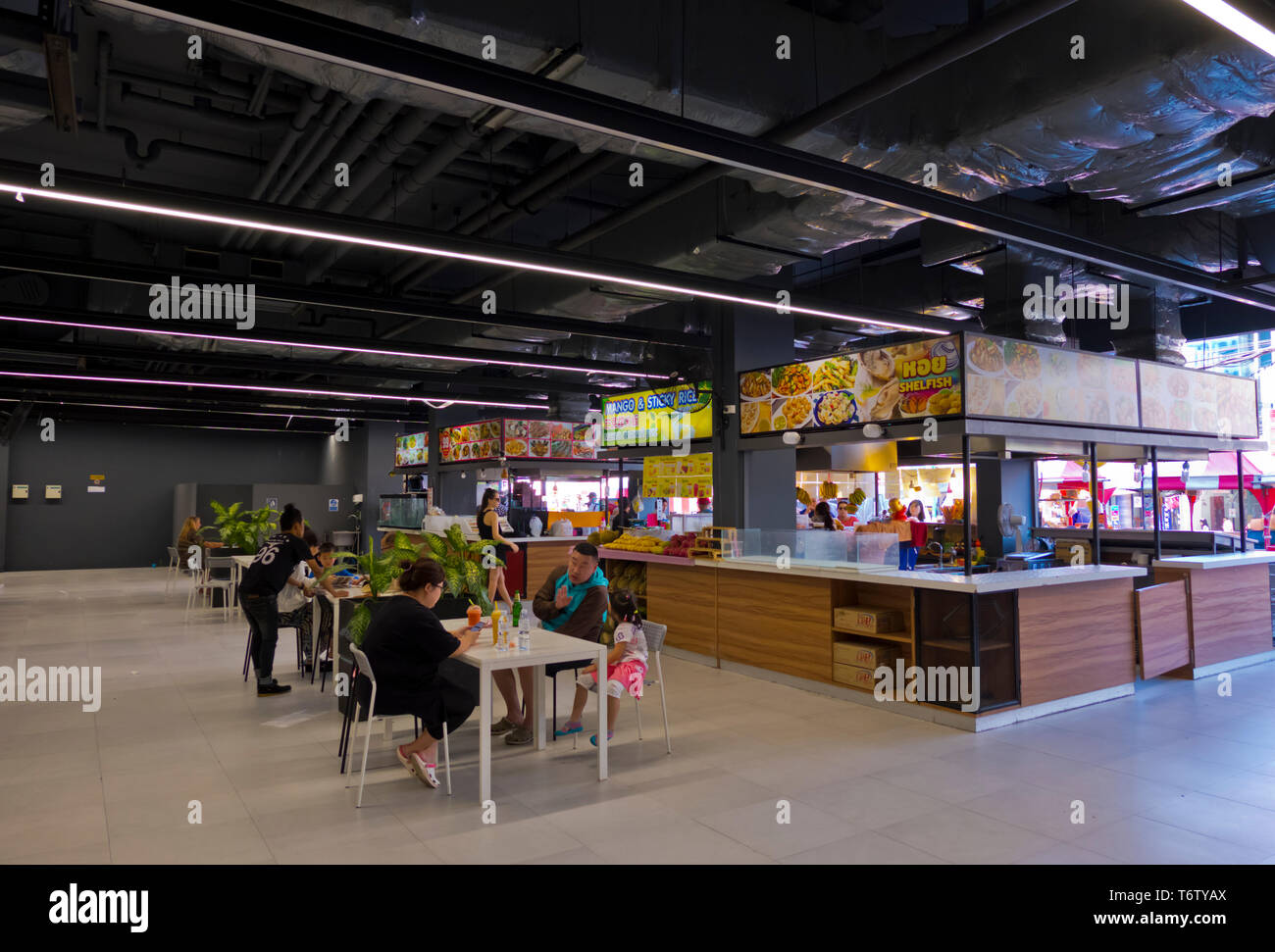 Eating area indoors, Patong, Phuket island, Thailand - Stock Image