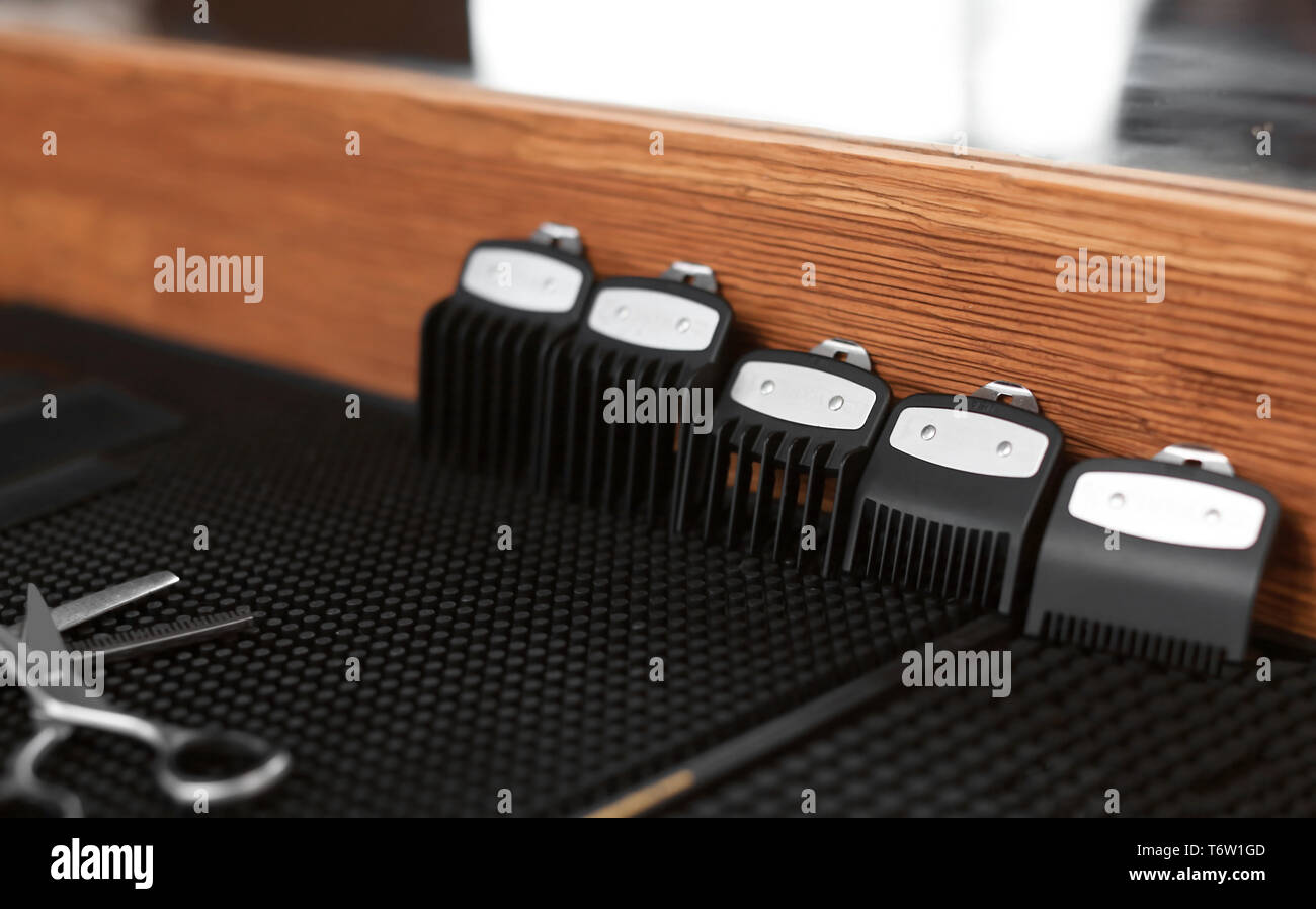 Trimmer attachment on table in hairdressing salon - Stock Image