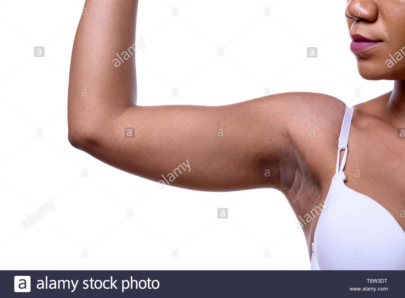 Bare shoulder and arm bent of a woman - Stock Image