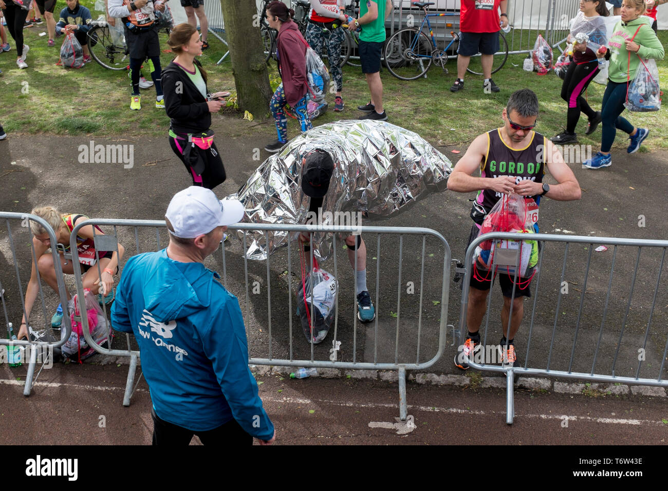 Local London park run volunteers load runners' bags into the lorries in Greenwich Park before the start of the 2019 London Marathon, on 28th April 2019, in London, England Stock Photo