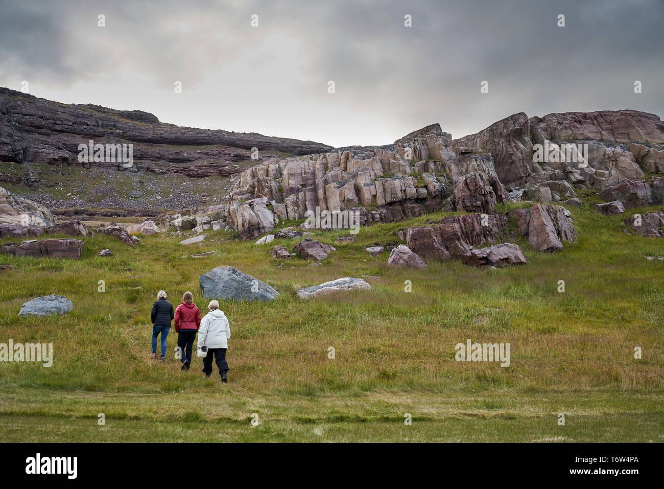 Tourists at Igaliku ancient Norse ruins at Gardar, South Greenland Stock Photo