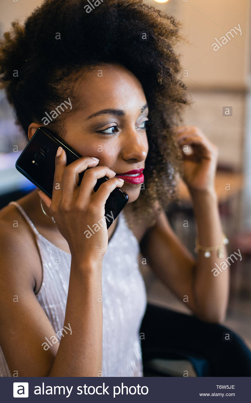 Black stylish woman on a cell phone call. - Stock Image