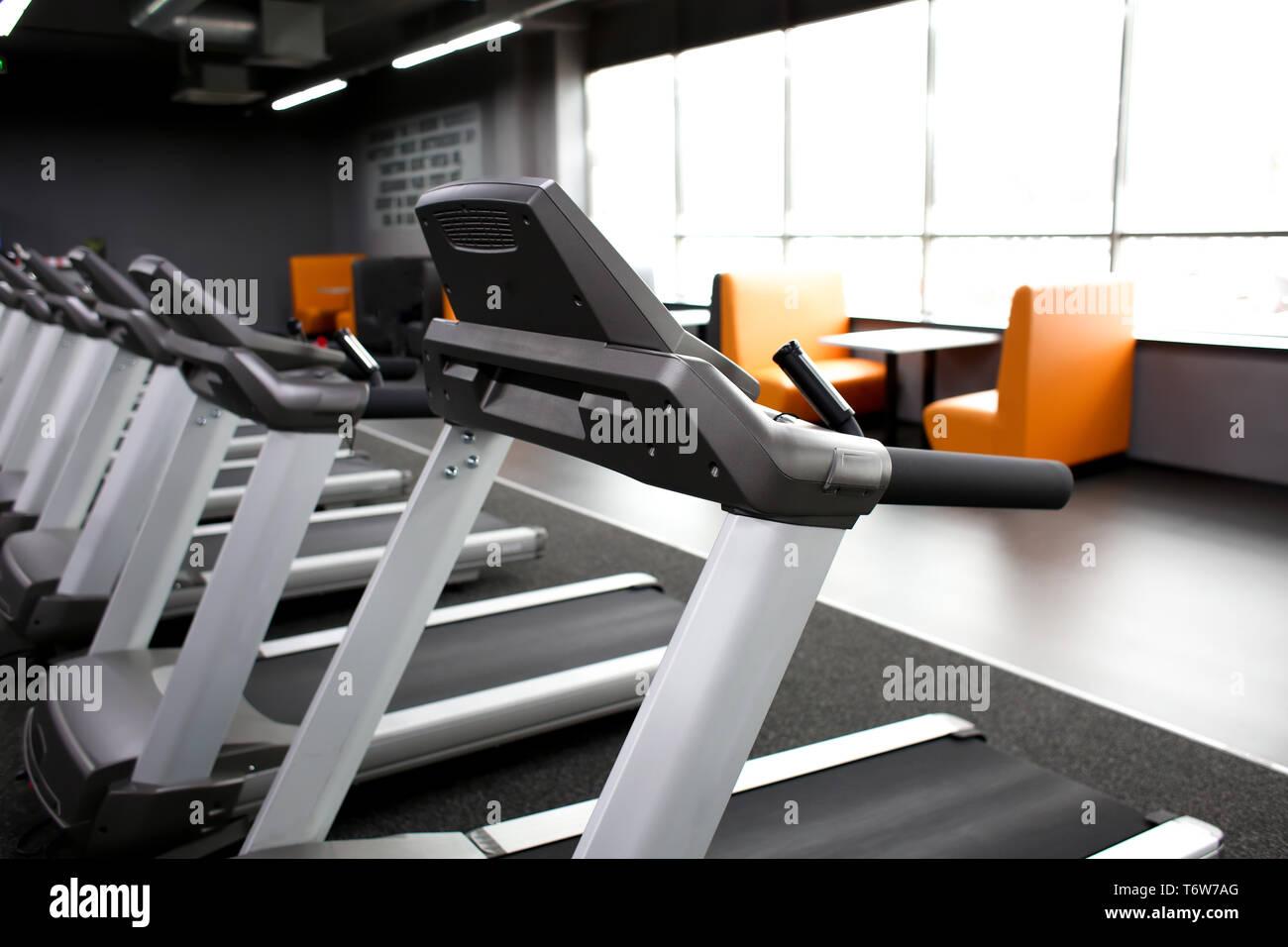 Modern treadmills in gym - Stock Image