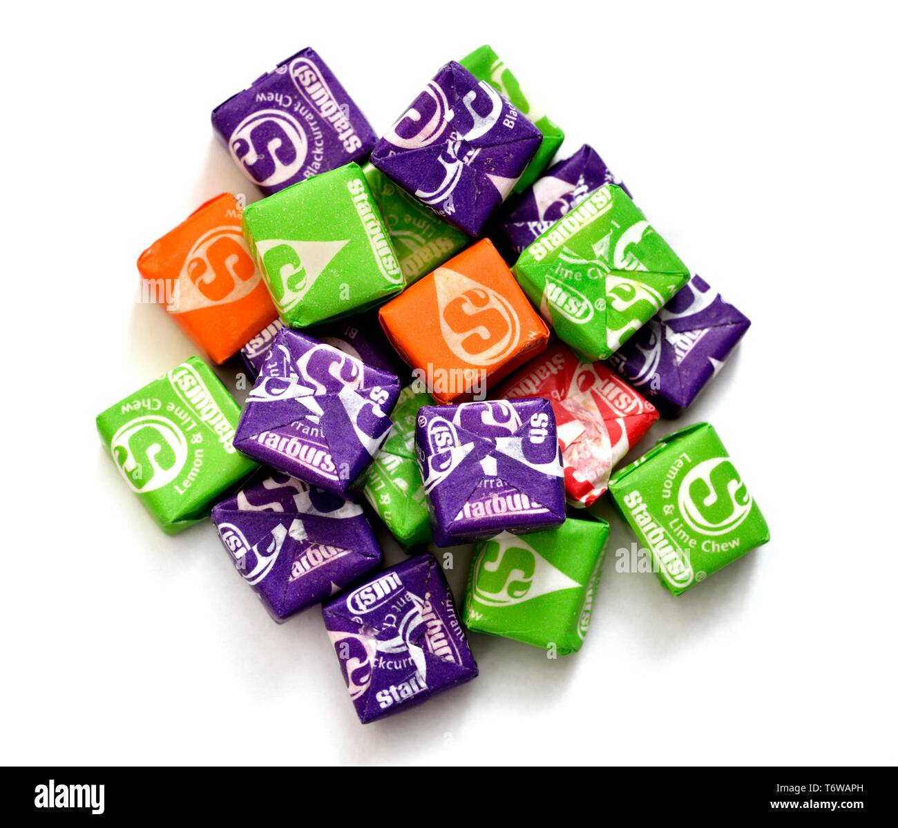 Starburst chewy sweets, white background - Stock Image