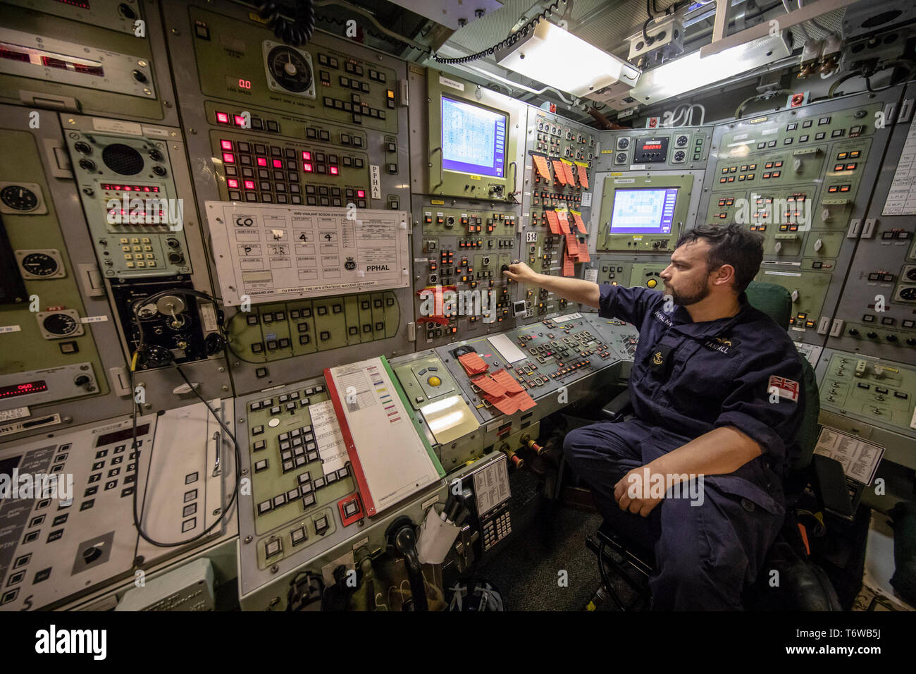 Embargoed to 0001 Friday May 3 Leading Engineering Technician Chris Randall onboard HMS Vigilant at HM Naval Base Clyde, Faslane, the Vanguard-class submarine carries the UK's Trident nuclear deterrent. - Stock Image
