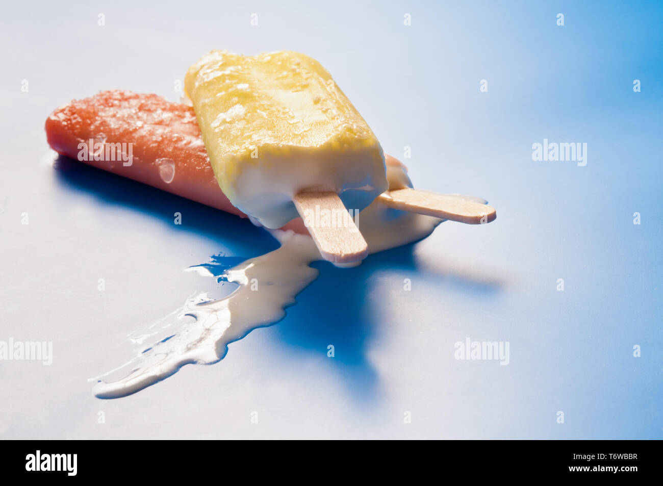 two ice lollies or ice pops melting - Stock Image