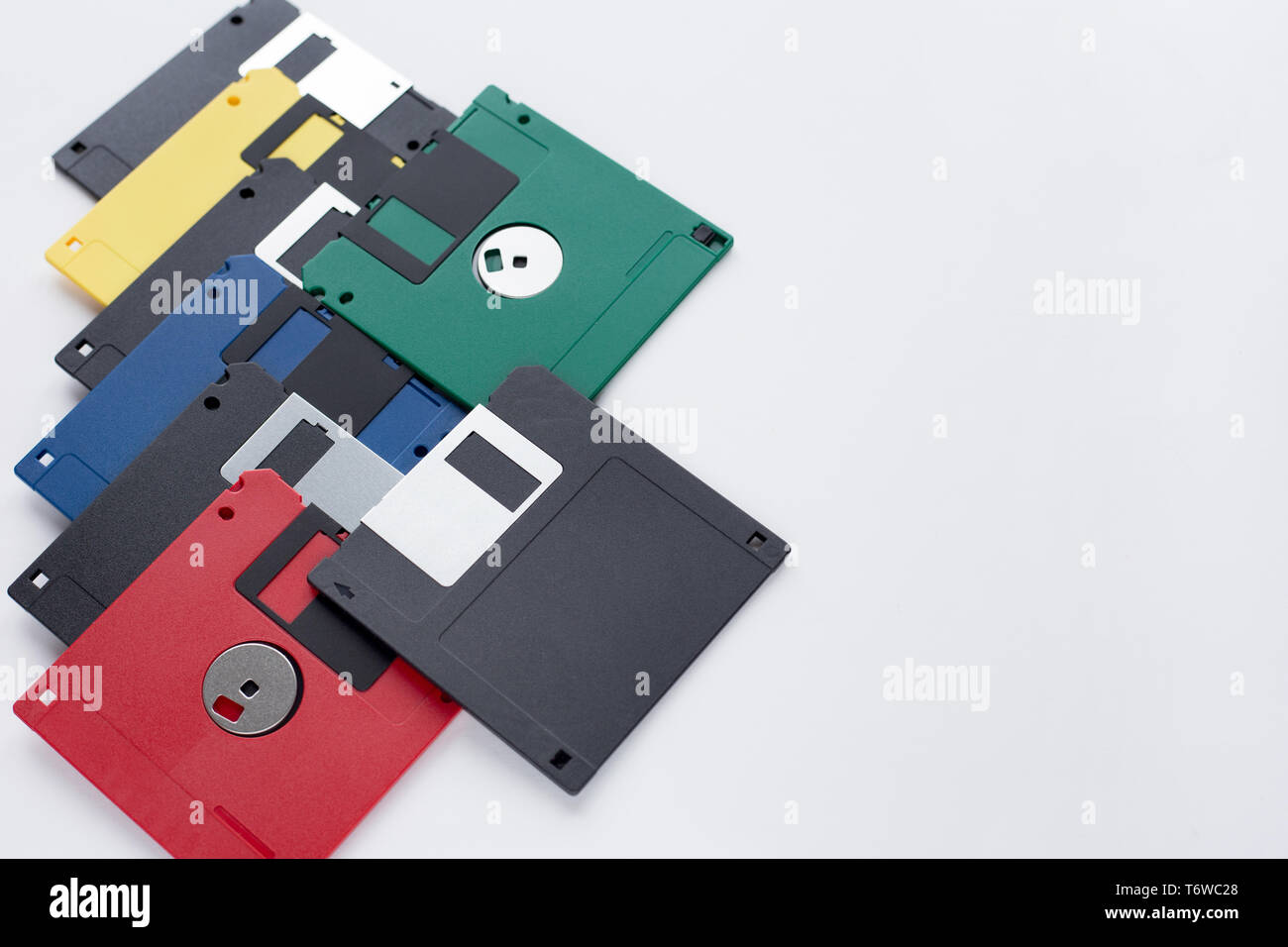 Group of multi-colored flexible disks isolated on a white background. Retro style. - Stock Image