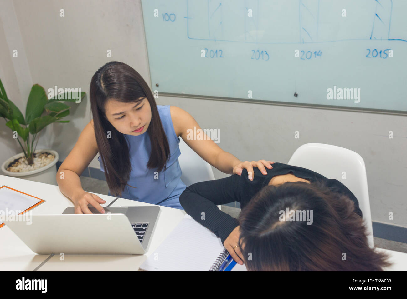 Office woman concern and worry of workmate - Stock Image