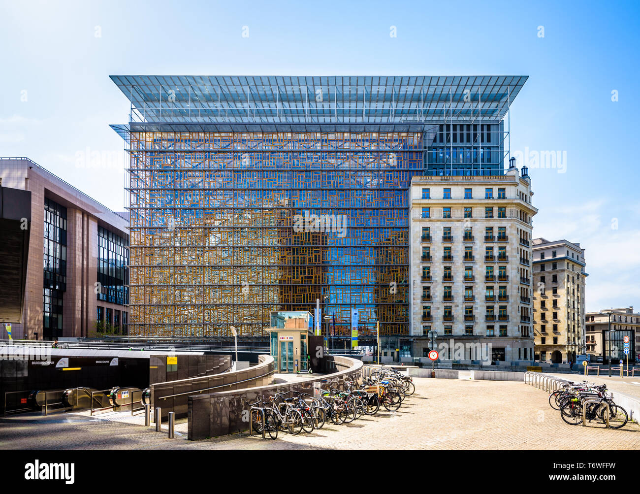 Front view of the Europa building, headquarters of the Council of the European Union in Brussels, Belgium, with bicycles parked in the foreground. - Stock Image