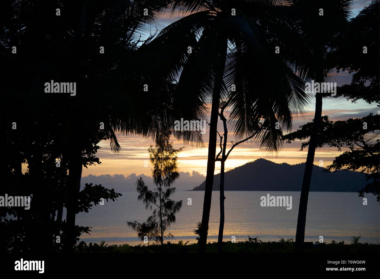 Early Morning Sunrise on Australia's Great Barrier Reef with Dunk Isl - Stock Image