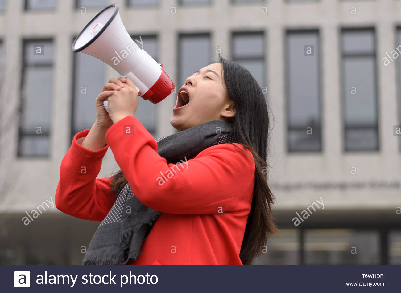 Modern young Chinese woman protesting - Stock Image