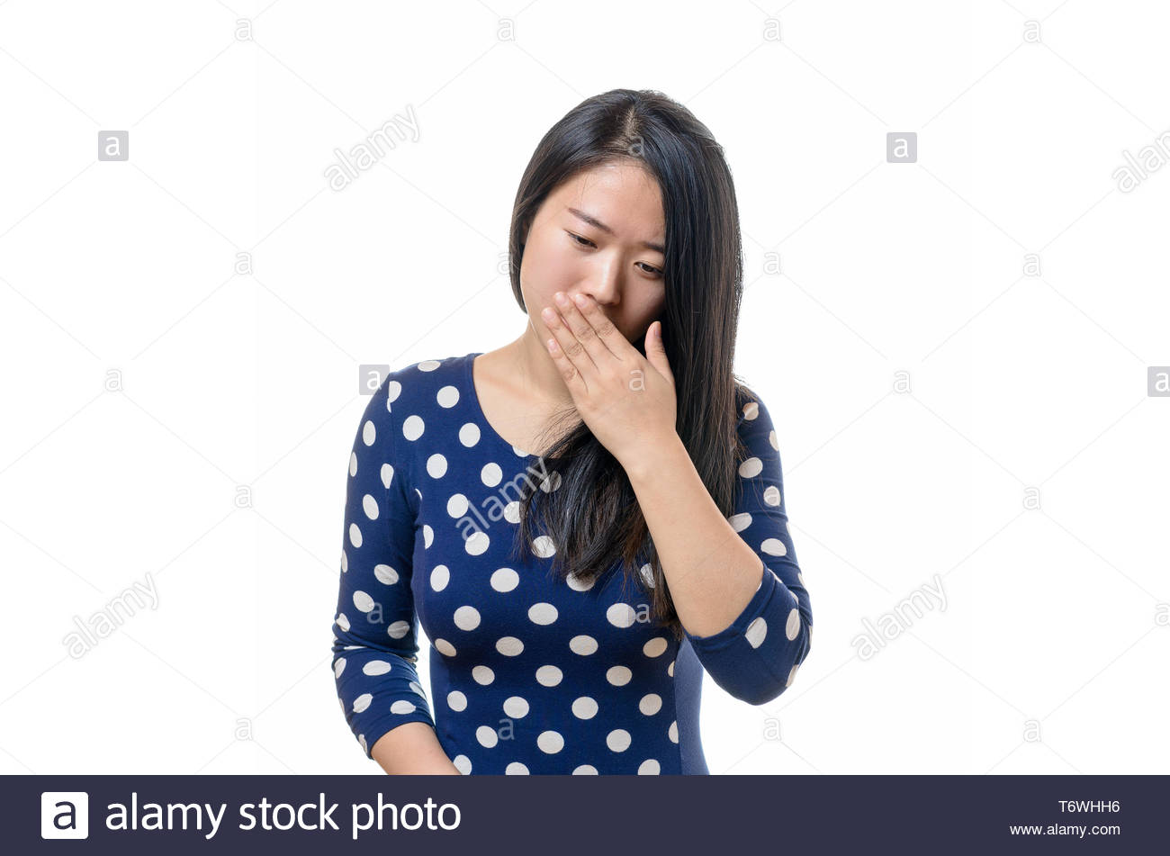 Polite young Chinese woman coughing - Stock Image