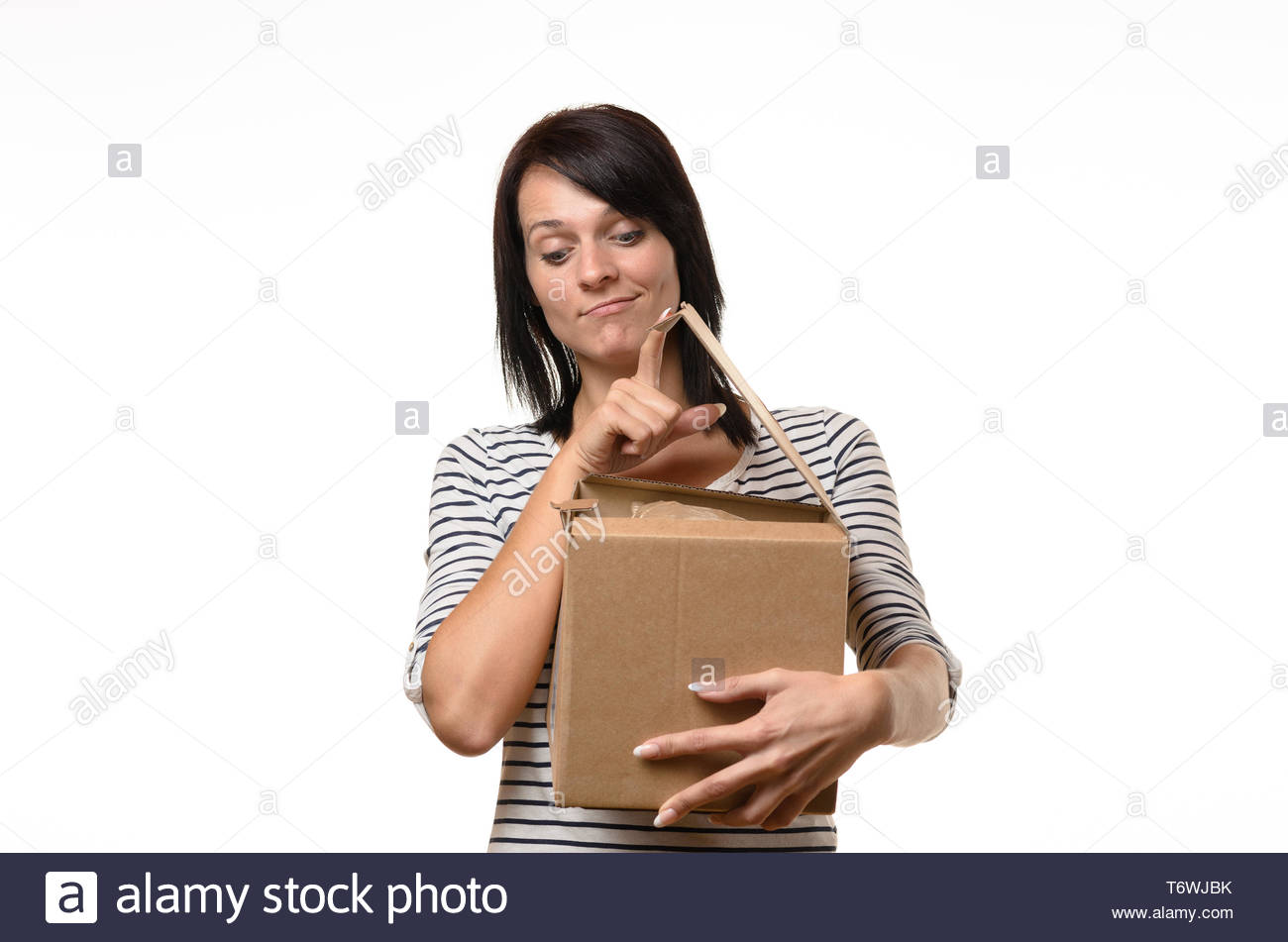 Critical woman with open cardboard box - Stock Image