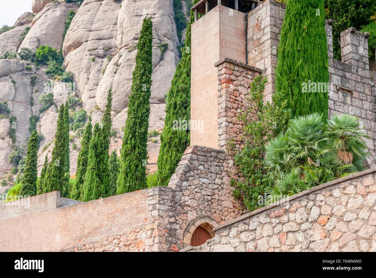 Santa Maria de Montserrat Abbey in Monistrol de Montserrat, Catalonia, Spain. Famous for the Virgin of Montserrat. Stock Photo