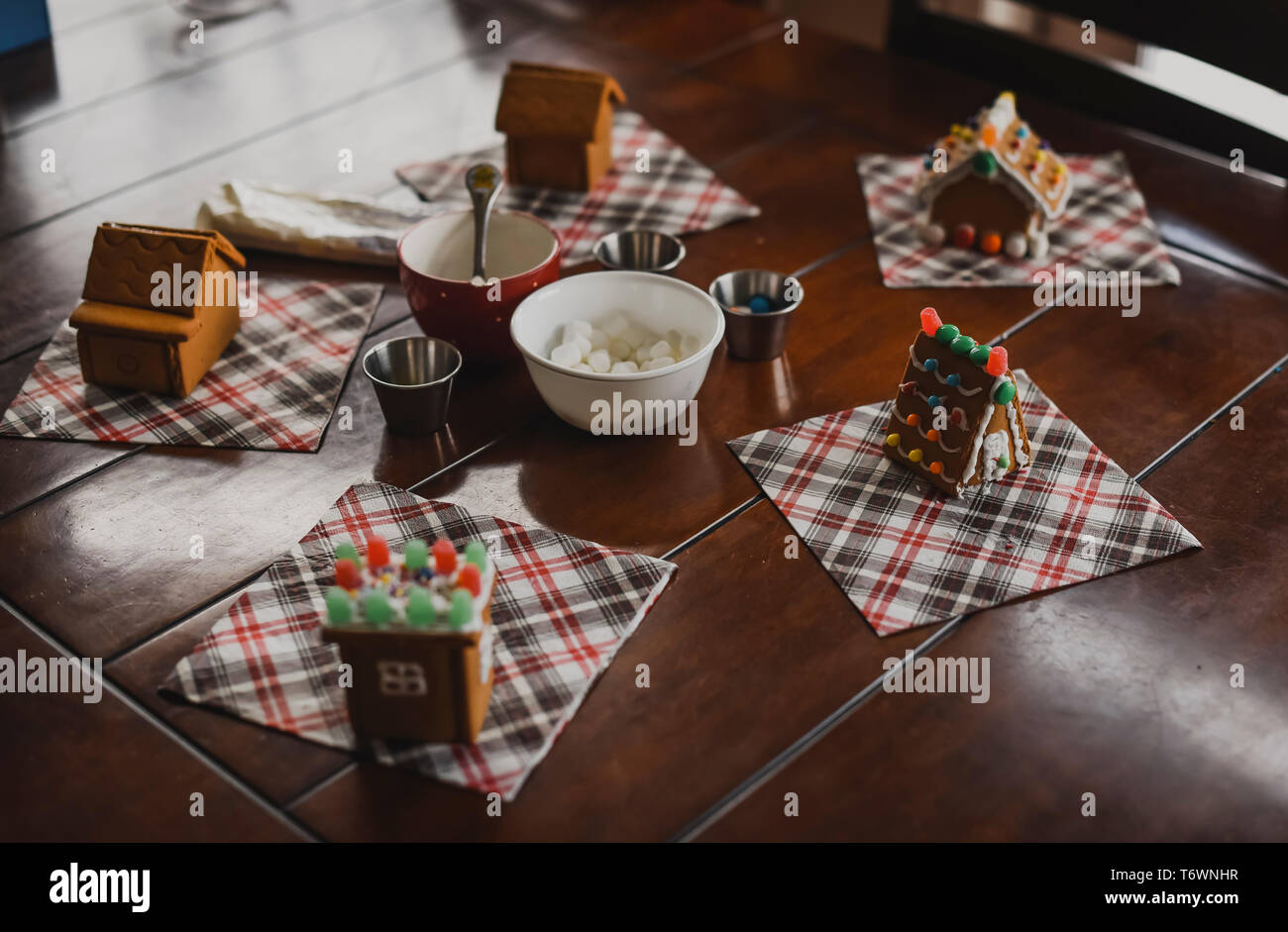 Gingerbread houses ready for decorating with icing and candies. - Stock Image
