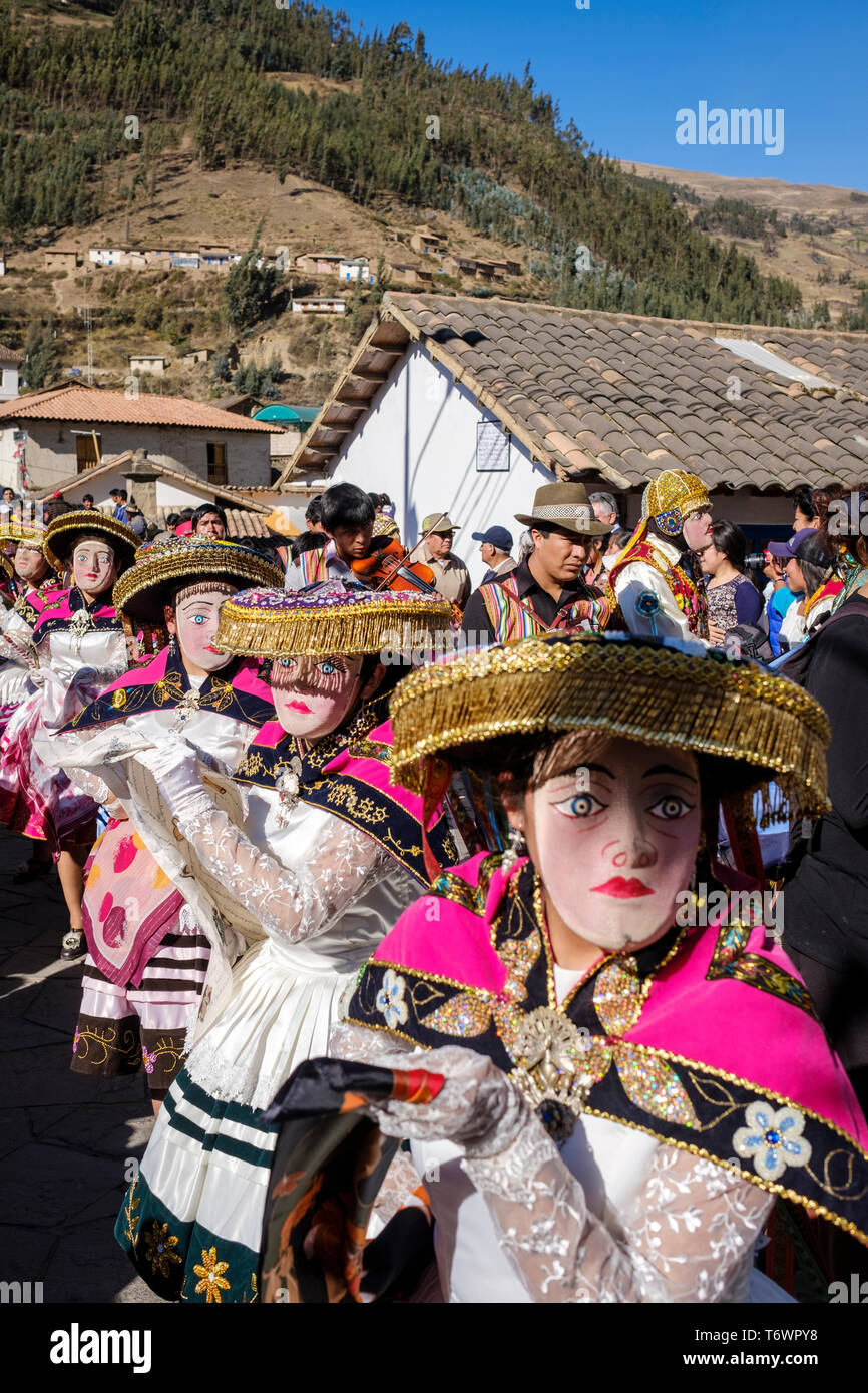 Masked and costumed characters on the parade of Festival of the
