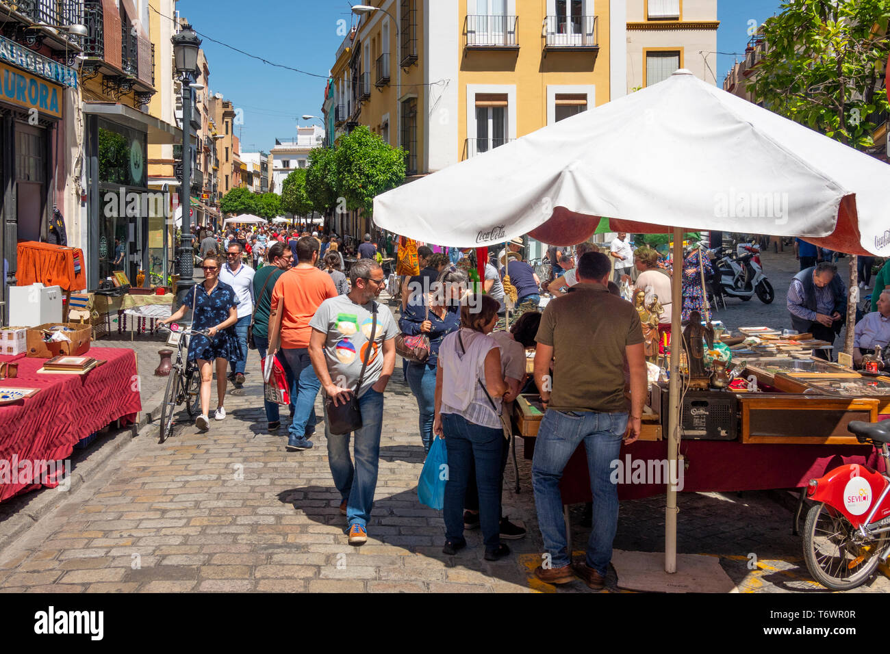 People browsing along Calle Feria at the Thursday flea market, the oldest in Europe - Stock Image
