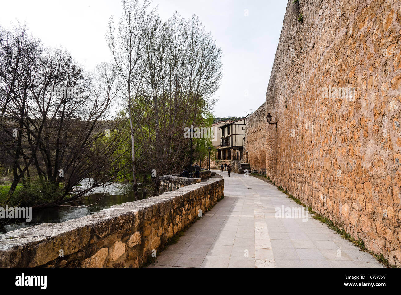 Scenic view of Arlanza River in the old medieval town of Covarrubias in Burgos, Castile and Leon - Stock Image