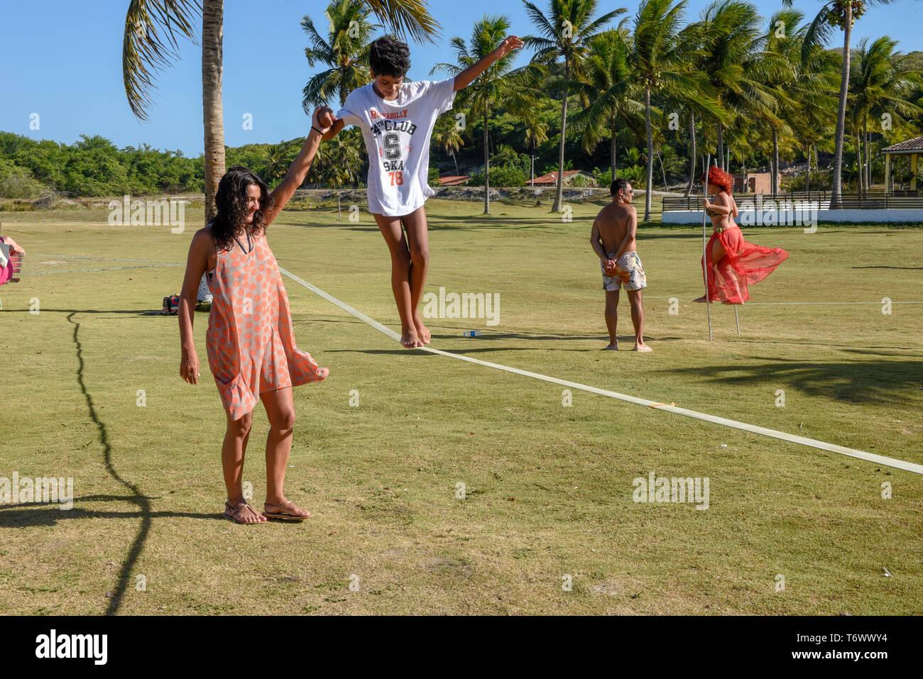 Pipa, Brazil - 23 January 2019: Woman on tightrope walker training near Pipa on Brazil - Stock Image