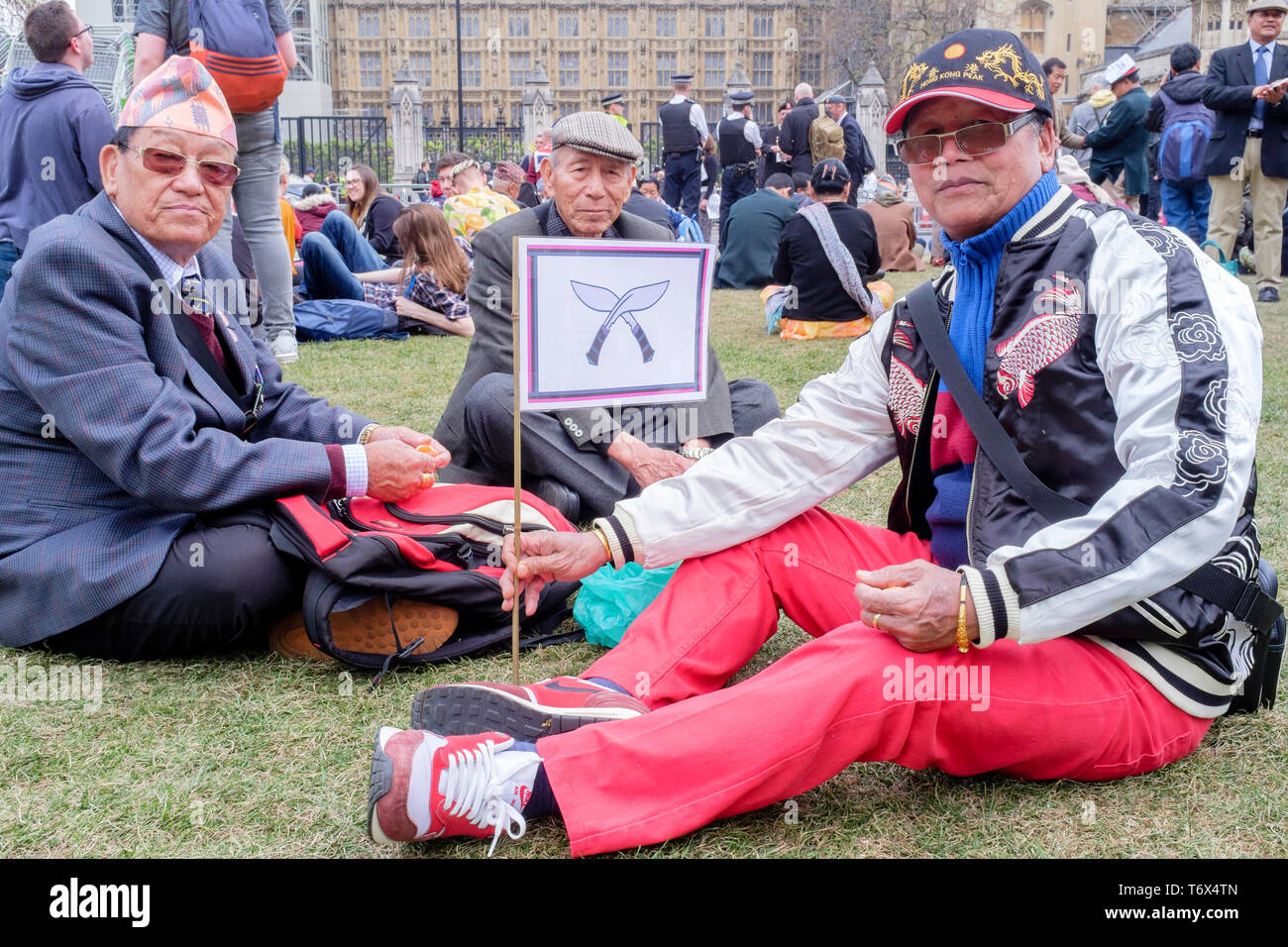 British Army Gurkha veterans rally in Parliament Square protesting against inequality in their army pensions and rights. London, UK - Stock Image