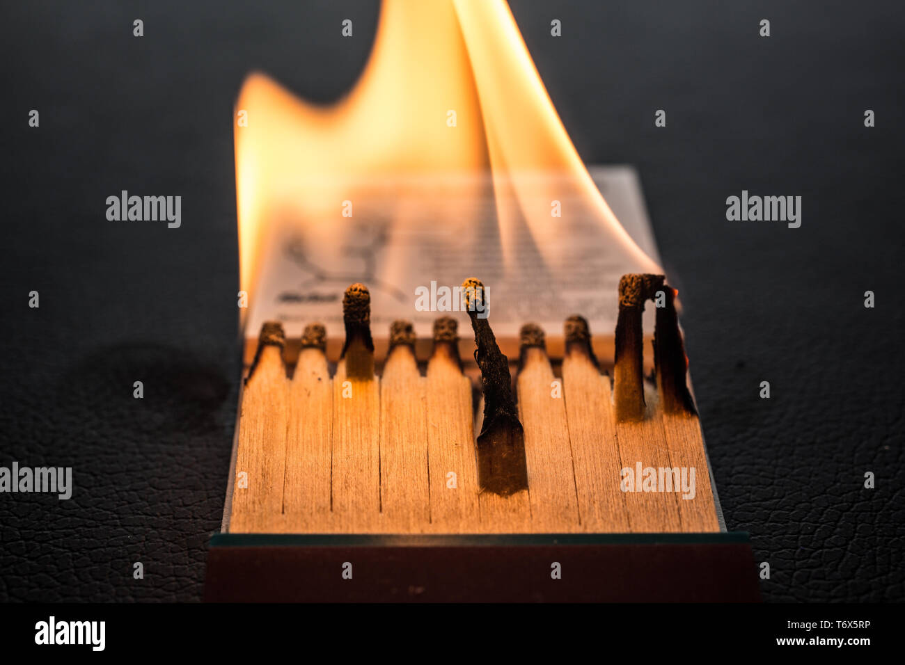 Matchbook with burning wood - Stock Image
