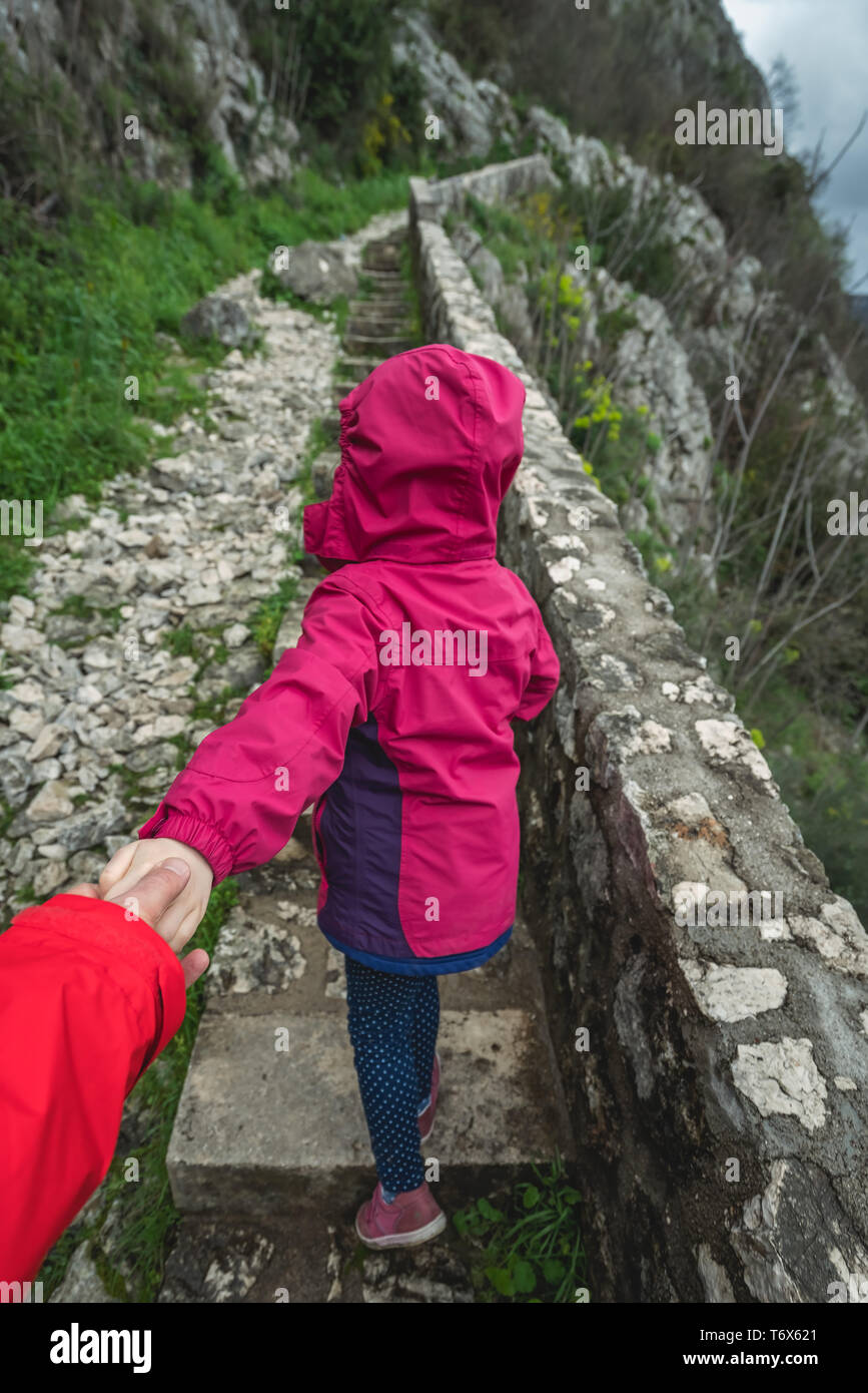 Little girl guiding father on a trail - Stock Image