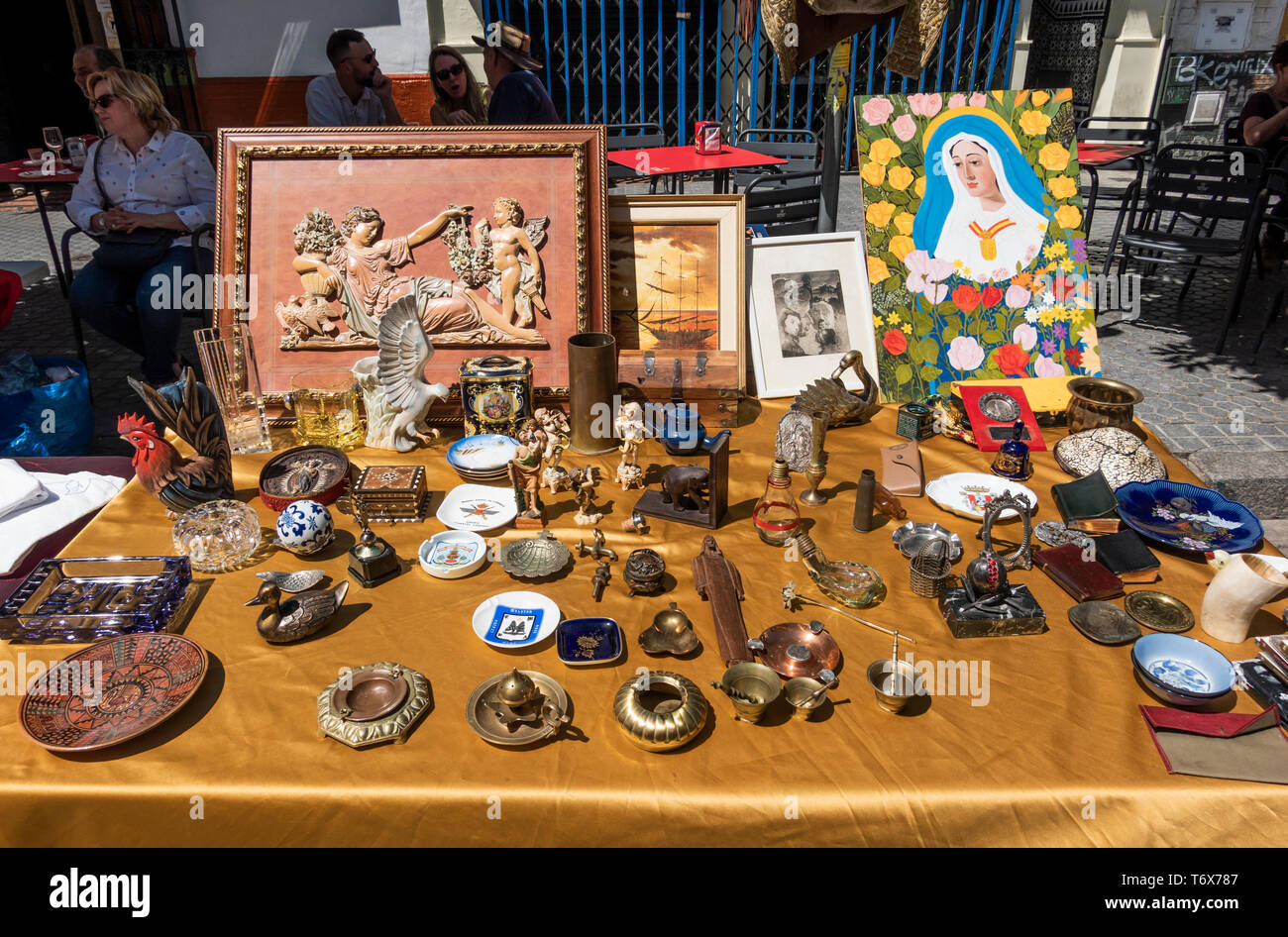 A mix of items for sale at the Thursday Market on Calle Feria in Seville - Stock Image