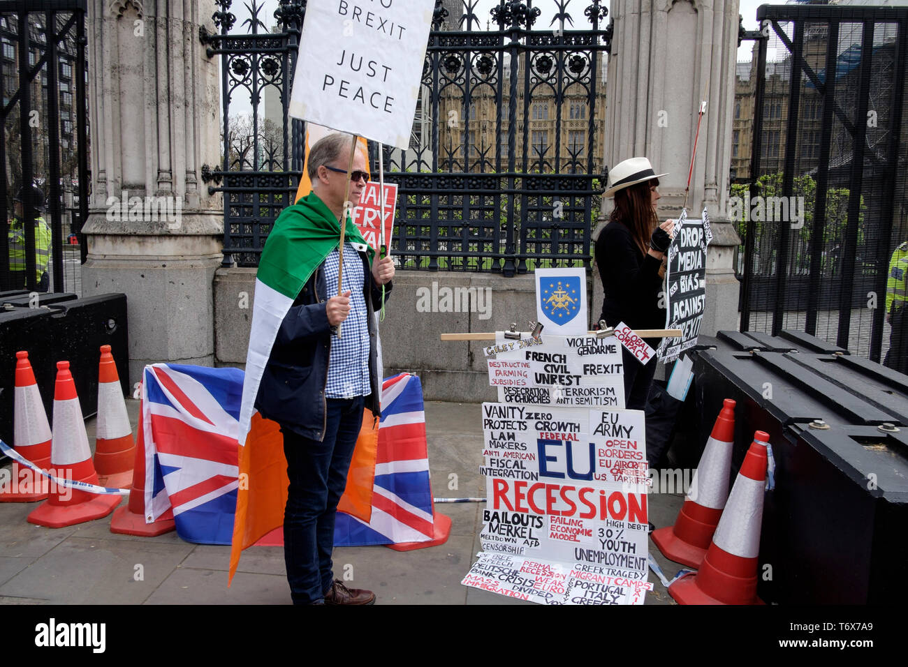 Pro Brexit  along with Remain protester outside Houses of Parliament, Westminster, London, UK. - Stock Image