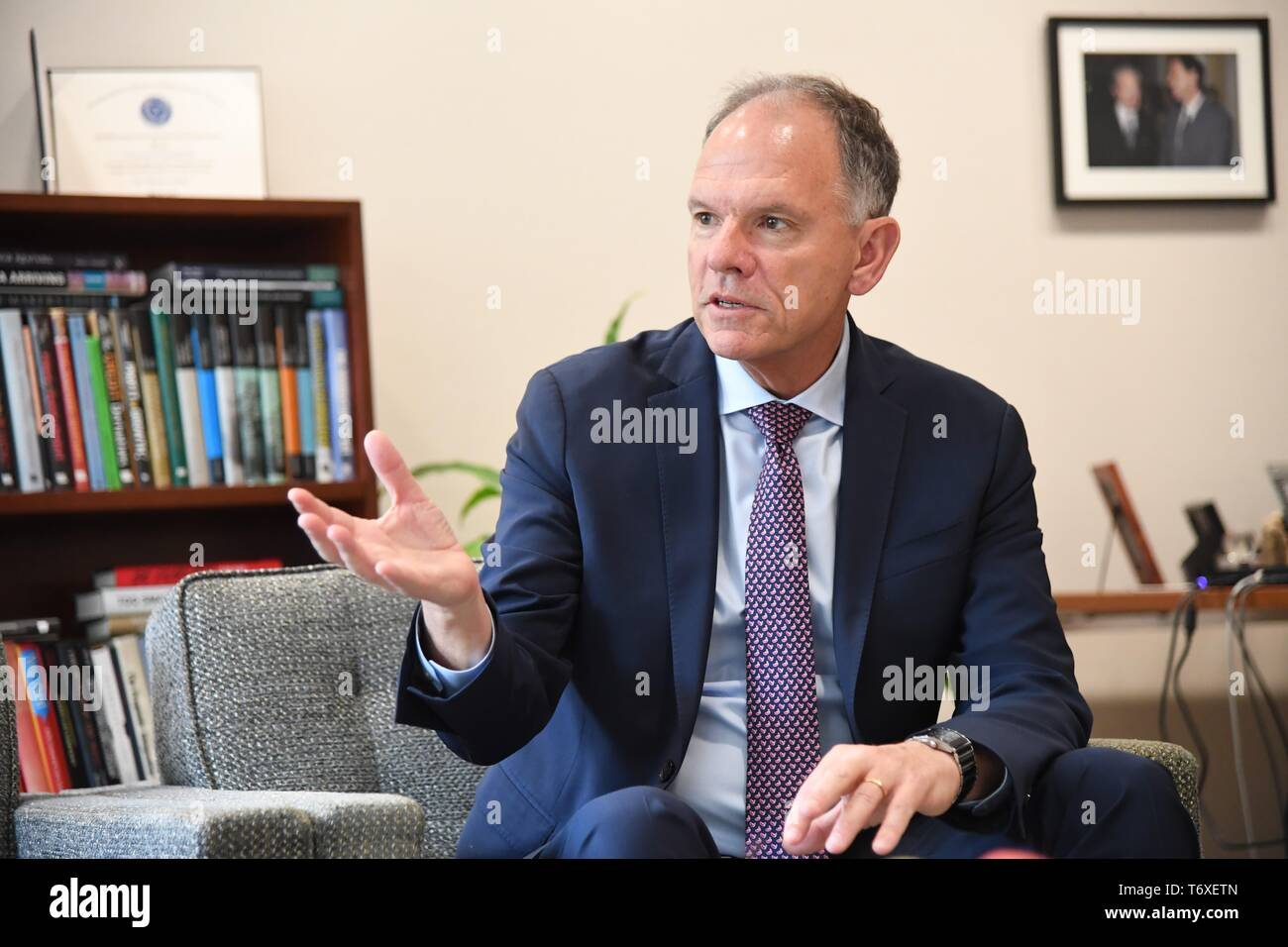 """Philadelphia, USA. 19th Apr, 2019. Geoffrey Garrett, dean of the Wharton School at the University of Pennsylvania, speaks to Xinhua during an exclusive interview in Philadelphia, the United States, April 19, 2019. Technology competition between the United States and China won't lead to so-called """"decoupling"""" because the two economies are """"tightly integrated,"""" said Geoffrey Garrett. TO GO WITH Interview: U.S.-China technology competition won't lead to """"decoupling,"""" says Wharton dean Credit: Yang Chenglin/Xinhua/Alamy Live News Stock Photo"""