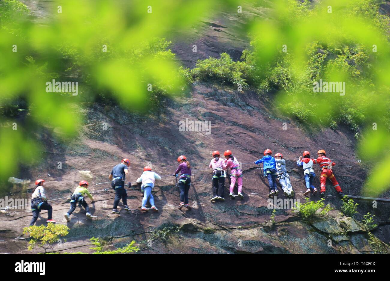 Hengyang, China's Hunan Province. 3rd May, 2019. Tourists visit the Shuilian (Water Curtain) Cave scenic area in Hengyang, central China's Hunan Province, May 3, 2019. People across China take advantage of the four-day Labor Day national holiday to get relaxed in recreational activities. Credit: Cao Zhengping/Xinhua/Alamy Live News - Stock Image