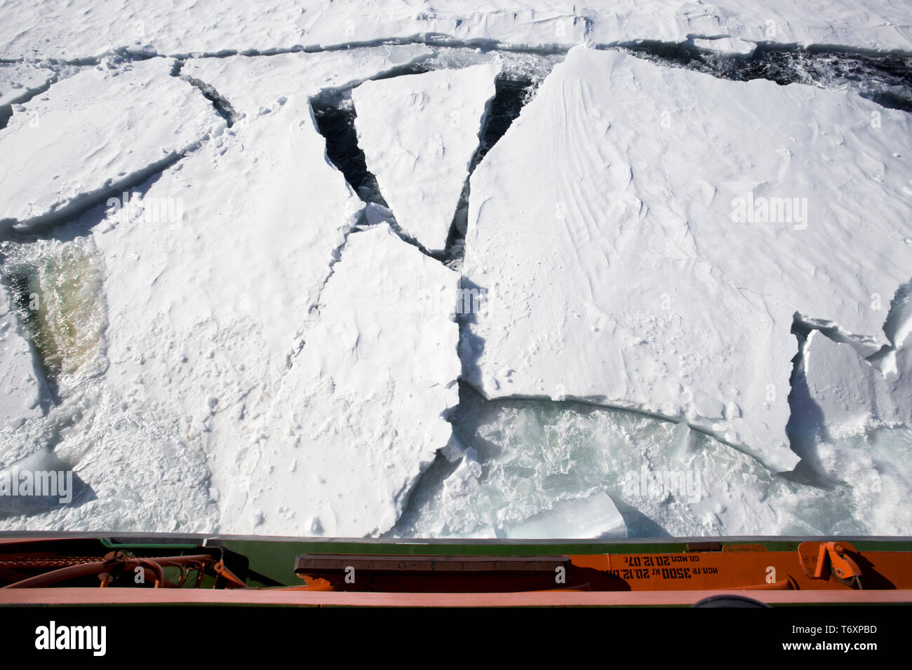 View of breaking sea ice  taken from deck of icebreaker travelling to North Pole on board Russian nuclear icebreaker 50 Years of Victory. Stock Photo