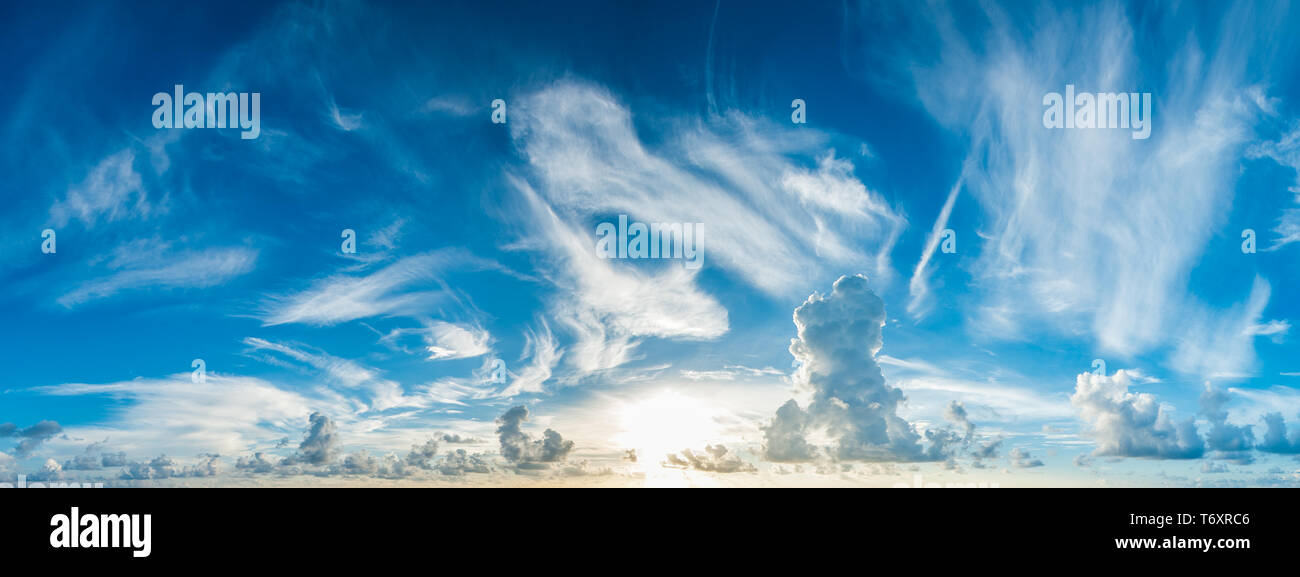 panorama of blue cloudy sky and rising sun - Stock Image