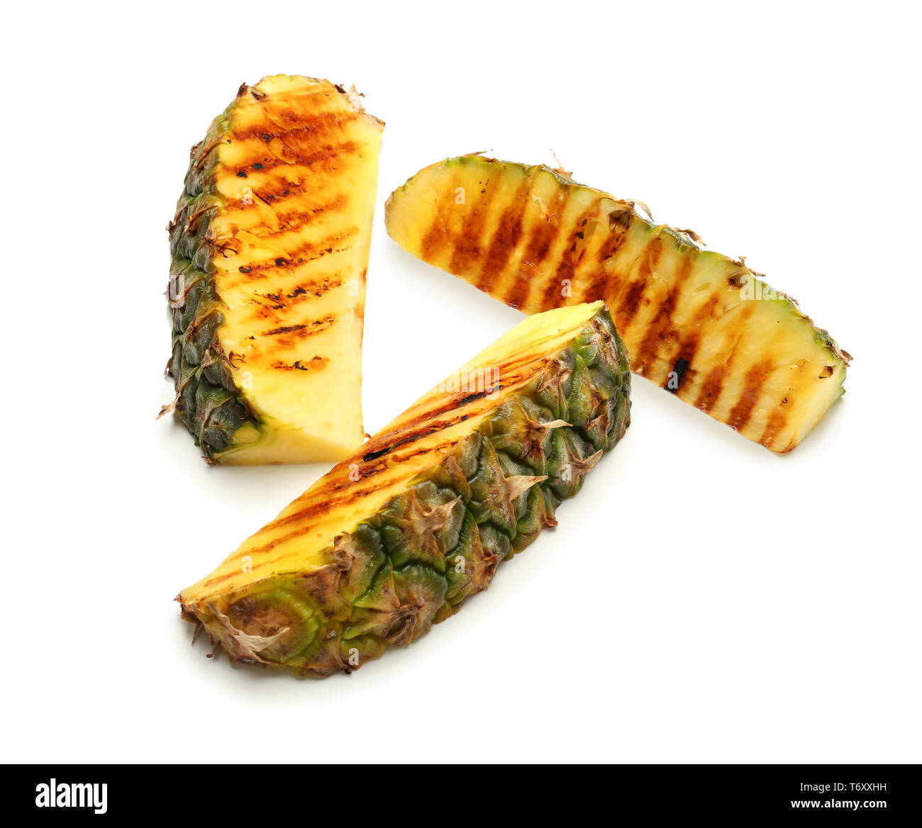 Grilled pineapple slices on white background - Stock Image