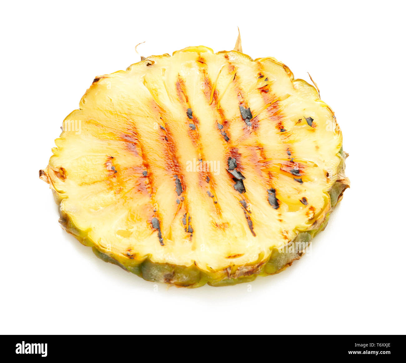Grilled pineapple slice on white background - Stock Image