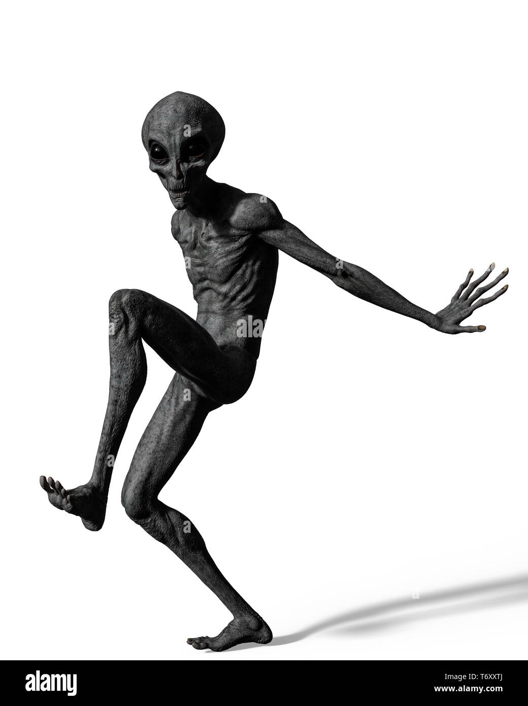 grey alien exploring arround. This alien will put some fun in yours creations Stock Photo