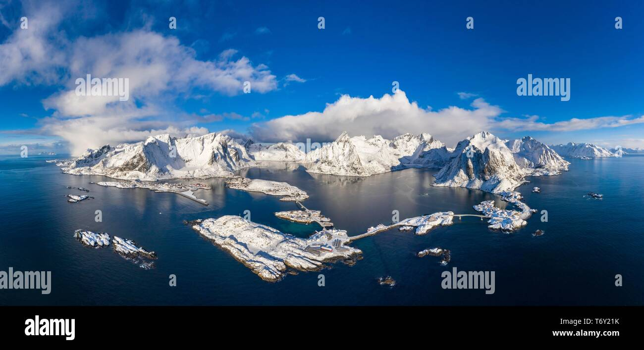 View to the villages Reine, Sakrisoy and Hamnoy, snowy mountains and fjords, Olstinden, Moskenesoya, Lofoten, Norway - Stock Image