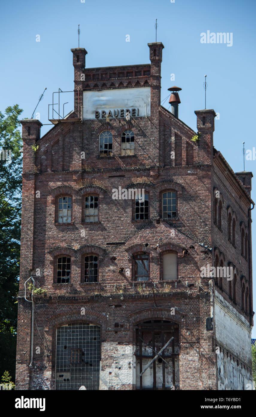 Demolished brick house without windows - Stock Image