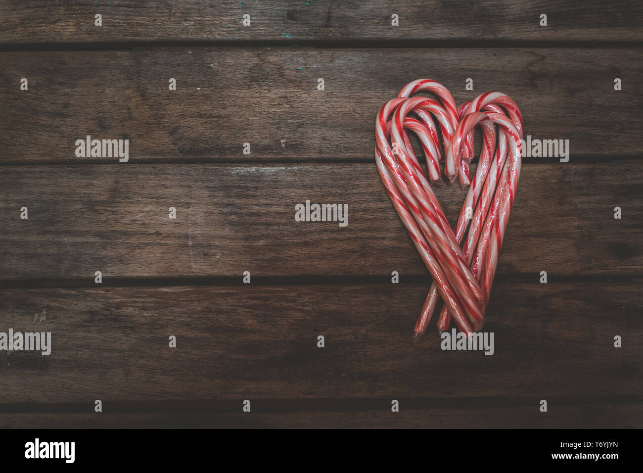 Candy canes making Valentine heart shape Stock Photo
