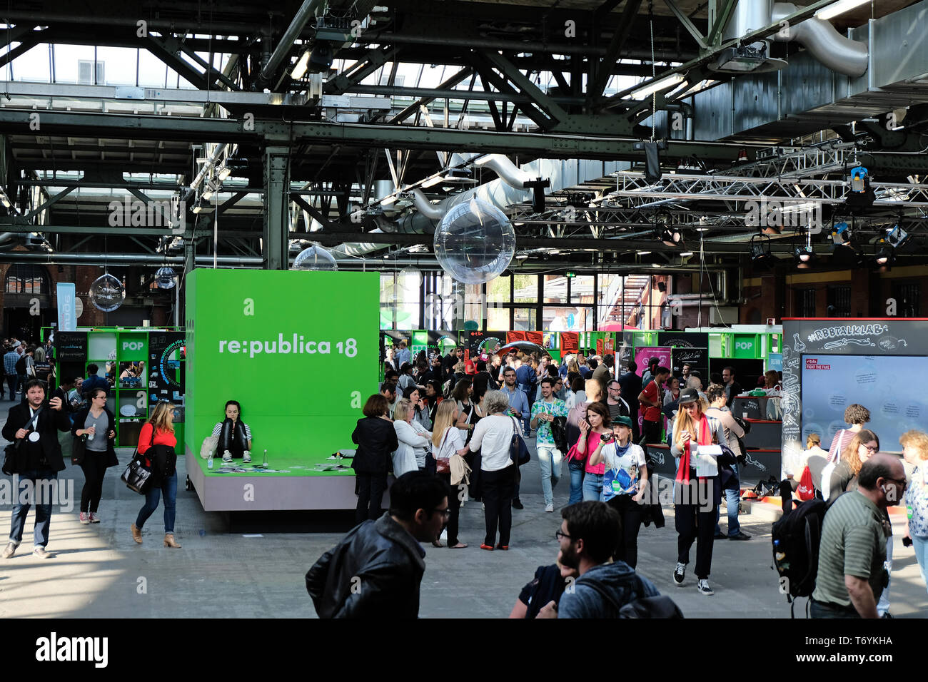 Berlin, Germany - May 3, 2018: View on the entrance hall of re:publica 2018 with visitors and many small booths. re:publica is a conference about Web  Stock Photo