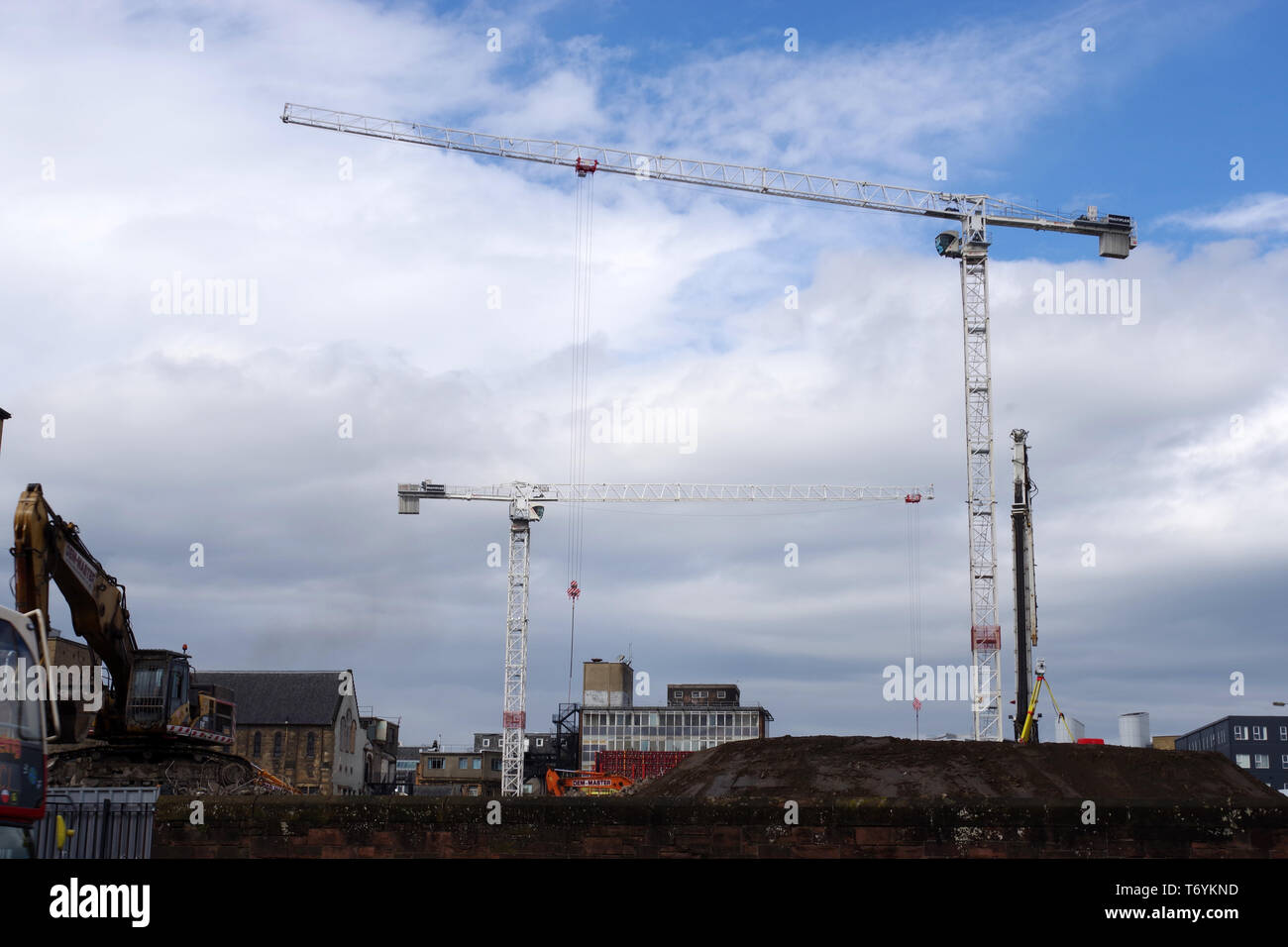 Cranes in Partick, Glasgow on the demolition site of the Western Infirmary Hospital. - Stock Image