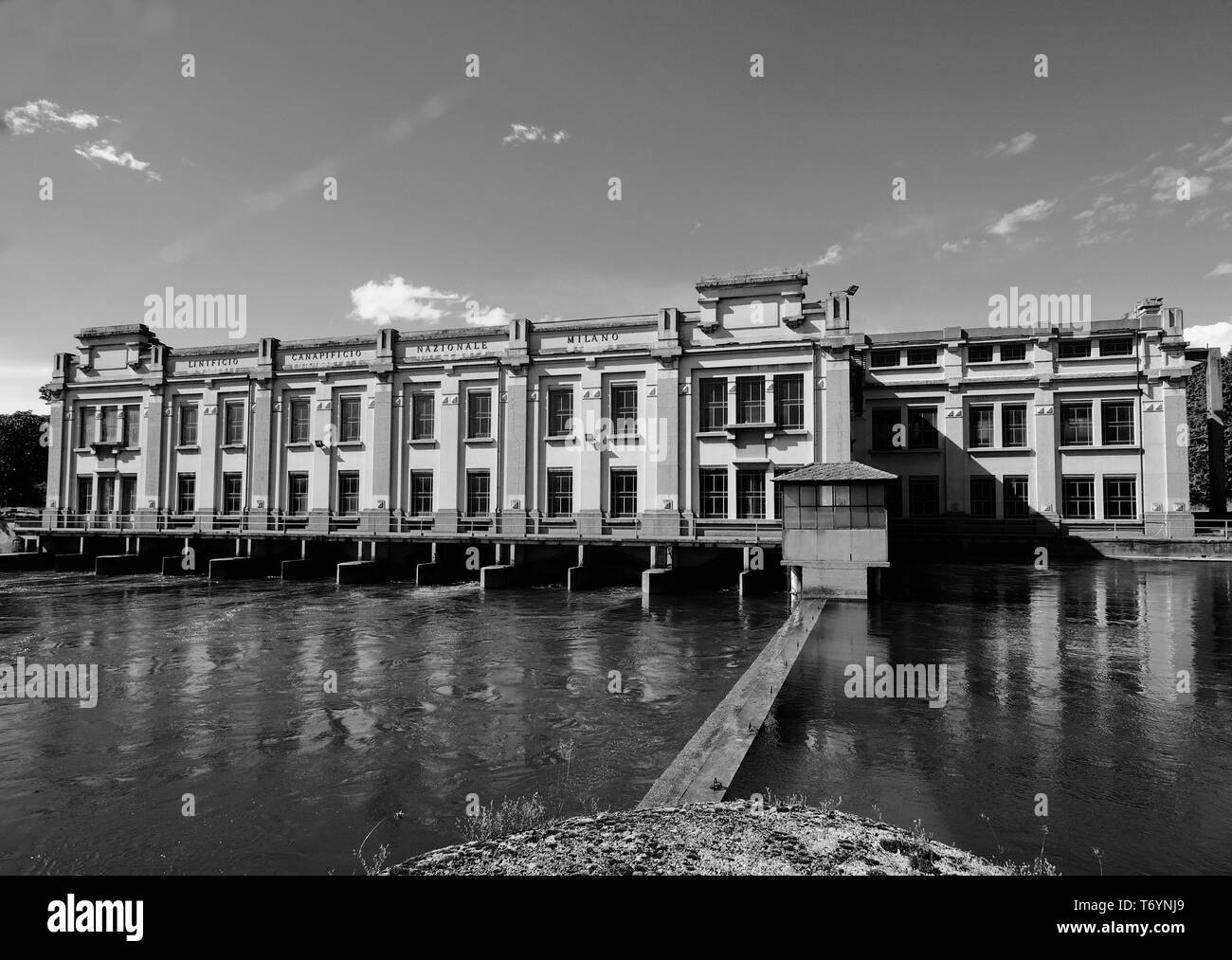 Historic old factory closed on Adda river, Lombardy, Italy Stock Photo