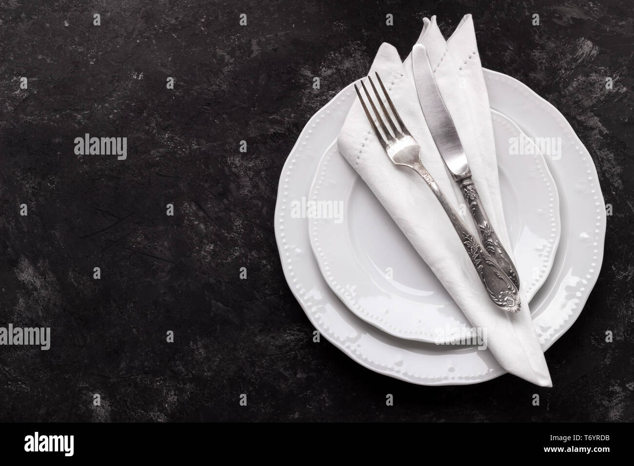 White plates and vintage cutlery - Stock Image