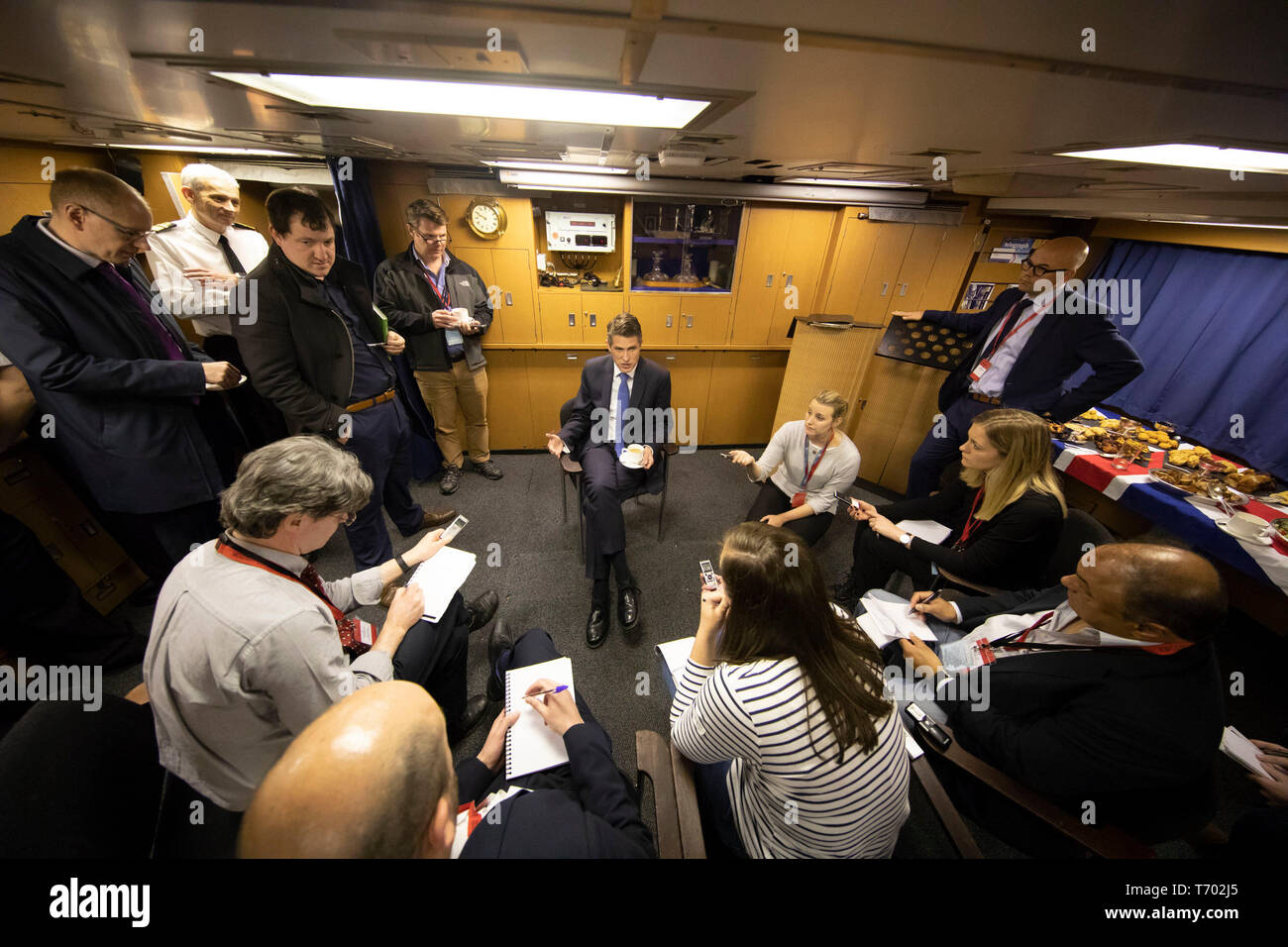 Former Defence Secretary Gavin Williamson (centre) speaking to the media during a visit to HMS Vigilant at HM Naval Base Clyde, Faslane, the Vanguard-class submarine carries the UK's Trident nuclear deterrent. - Stock Image