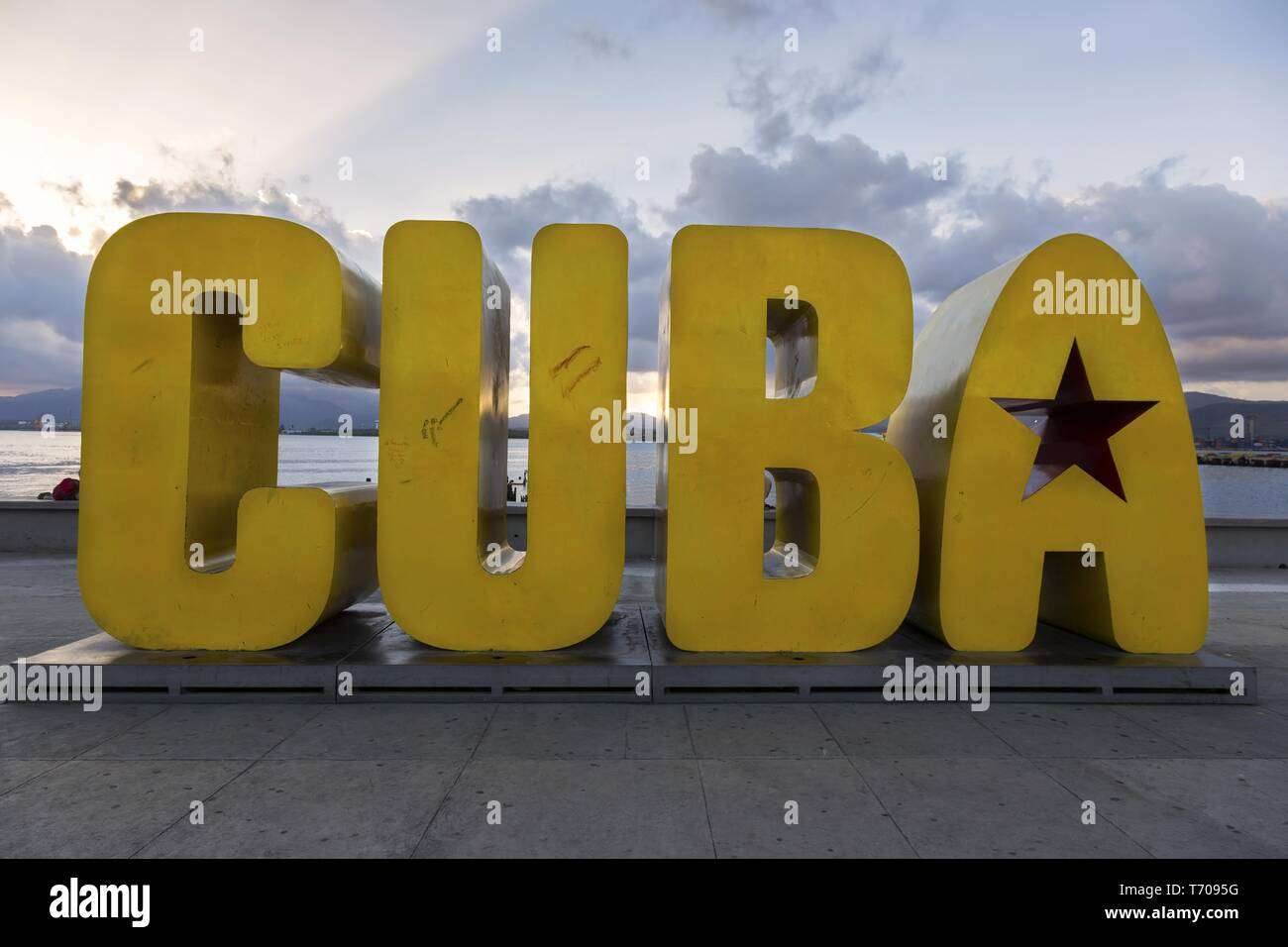 Big Yellow Cuba Sign on Santiago De Cuba Waterfront.  Town of Santiago is considered the birthplace of Cuban Revolution - Stock Image